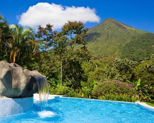16565765 - pool with a view of the green side of arenal volcano, costa rica.